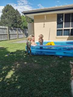 in pool with daddy